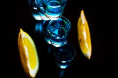 Popular drink shot kamikaze based on vodka, blue curacao and lem Royalty Free Stock Images