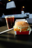 Popular fastfood: soft hamburger with fresh meat. On the table Royalty Free Stock Images