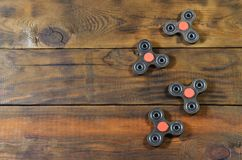Popular finger spinner device. Modern fidget spinning toy on bearings. Spin it in hands. Popular finger spinner. Modern fidget spinning toy on bearings. Spin it royalty free stock photos