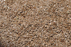 Popular flaxseeds or linseeds, for their nutritional and health benefits. Horizontal shot from above of a large pile of brown flax seeds at the market, also Royalty Free Stock Images