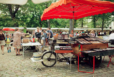 Popular flea market traders waiting for customers of retro glasses and furniture Stock Photo