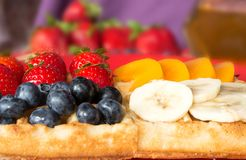 The popular foster waffle on a red plate, with fruits. The popular foster waffle on a red plate, with fruit Stock Photos
