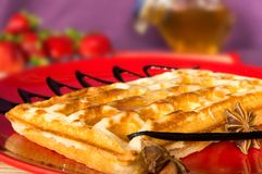 The popular foster waffle on a red plate, with fruits Stock Photos