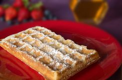 The popular foster waffle on a red plate, with fruits. The popular foster waffle on a red plate, with fruit Stock Images