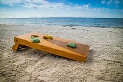 A popular game of Corn Hole in a fine weather at Fort Myers, Florida. A great way to spend a relaxing afternoon while playing bean bag in Bowditch Point Park stock photography