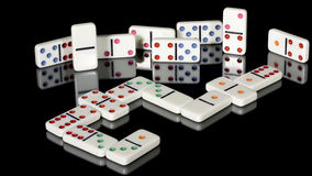 Popular game of Dominos on a reflective table Royalty Free Stock Photo