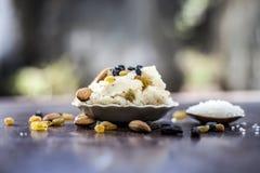 Popular Indian and Asian dessert Suji ka halwa or Rava with organic almonds, cashews and black & golden raisns in a clay bowl on w. Popular Indian and Asian stock photos