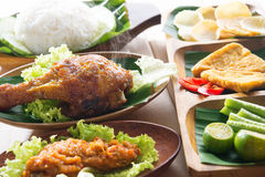 Popular Indonesia fried chicken rice. Popular delicious Indonesian local food nasi ayam penyet, indonesian fried chicken rice with sambal belacan. Fresh hot with stock photo