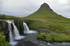 Kirkjufell and Kirkufellsfoss on a cloudy evening, Iceland royalty free stock photo