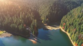 Popular Lake Among Dense Forests Against Pictorial Hills Stock Photos