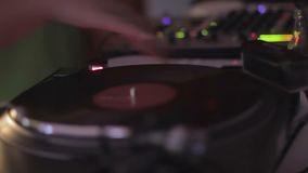 Popular male disc jockey playing music at social event, spinning vinyl record. Stock footage stock video footage