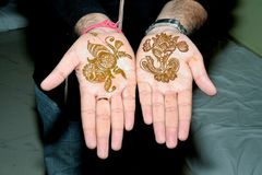 Popular Mehndi Designs for Hands Indian traditions. Popular Mehndi Designs for Hands or Hands painted with Mehandi Indian traditions royalty free stock photo