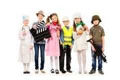 Popular occupations. A group of children dressed in costumes of different professions. Isolated over white Stock Photos