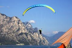 Popular paragliding above a lake,  Lago di Garda, Italy Royalty Free Stock Photography