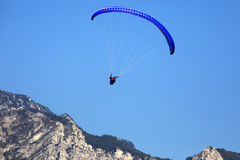 Popular paragliding above a lake,  Lago di Garda, Italy Royalty Free Stock Image