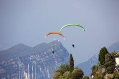 Popular paragliding above a lake,  Lago di Garda, Italy Royalty Free Stock Photo