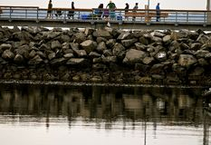 Edmonds Pier Fishing and Crabbing. A popular pass time among residents is to go to scenic Edmonds Pier in Washington state to fish or go crabbing for a great Royalty Free Stock Image