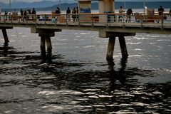 Edmonds Pier Fishing and Crabbing. A popular pass time among residents is to go to scenic Edmonds Pier in Washington state to fish or go crabbing for a great Royalty Free Stock Photography