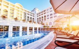 The popular resort Amara Dolce Vita Luxury Hotel. With pools and water parks and recreational area along the sea coast in Turkey a. T sunset. Tekirova-Kemer stock photography