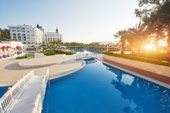 The popular resort Amara Dolce Vita Luxury Hotel. With pools and water parks and recreational area along the sea coast. In Turkey at sunset. Tekirova-Kemer stock photography