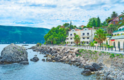 The popular resort. The scenic promenade of Herceg Novi with the modern hotels, luxury villas and cozy cafes for tourists, Montenegro Stock Photo