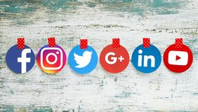 Popular round social media icons taped on old wood stock images