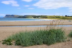 Popular sandy tourist beach. The sand beach at the town of Ballycastle in County Antrim in Northern Ireland royalty free stock photo
