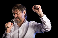 Popular singer with a microphone Stock Images
