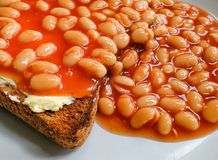 Freshly prepared plate of Beans On Toast seen on a table. Stock Photos