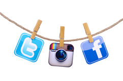 Popular social media. Facebook, Twitter,instagram hanging on the clothesline isolated on white background Stock Photos