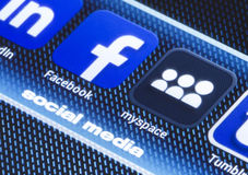 Popular social media icons facebook myspace and other on smart phone screen close up Stock Images