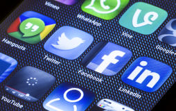 Popular social media icons facebook twitter and other on smart phone screen close up Stock Photos