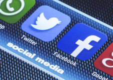 Popular social media icons facebook twitter and other on smart phone screen close up Royalty Free Stock Photo