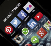 Popular social media icons Facebook, Twitter and other on smart phone screen close up Stock Images