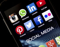 Popular social media icons Facebook, Twitter and other on smart phone screen close up royalty free stock images