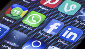 Popular social media icons facebook whatsapp and other on smart phone screen close up Stock Photos