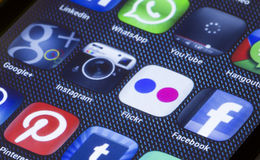 Popular social media icons flickr instagram and other on smart phone screen close up. BELGRADE - JULY 05, 2014 Popular social media icons flickr instagram and Royalty Free Stock Photos