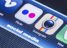 Popular social media icons flickr instagram and other on smart phone screen close up Royalty Free Stock Photo