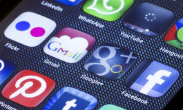 Popular social media icons gmail google plus and other on smart phone screen close up. BELGRADE - JULY 05, 2014 Popular social media icons gmail google plus and Stock Photo