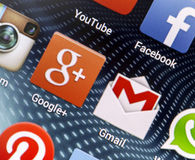 Popular social media icons Google+, Gmail and other on smart phone screen close up Stock Images