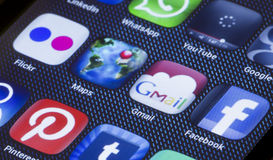 Popular social media icons google maps gmail and other on smart phone screen close up Royalty Free Stock Image
