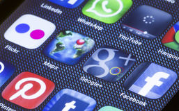Popular social media icons google maps google plus and other on smart phone screen close up Stock Photography