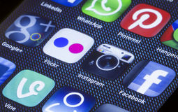 Popular social media icons instagram flickr and other on smart phone screen close up Stock Photos