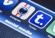 Popular social media icons instagram tumbir and other on smart phone screen close up Stock Photo