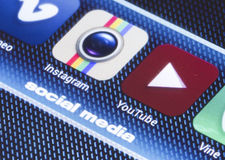 Popular social media icons instagram youtube and other on smart phone screen close up Stock Images