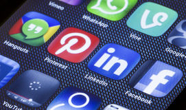 Popular social media icons linkedin pinterest and other on smart phone screen close up Stock Photo