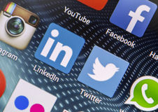 Popular social media icons Linkedin, Twitter and other on smart phone screen close up Stock Photography