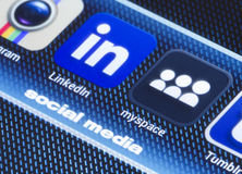 Popular social media icons myspace linkedin and other on smart phone screen close up Royalty Free Stock Photo