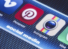 Popular social media icons pinterest instagram and other on smart phone screen close up Royalty Free Stock Photo