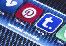 Popular social media icons pinterest tumbir and other on smart phone screen close up Stock Images